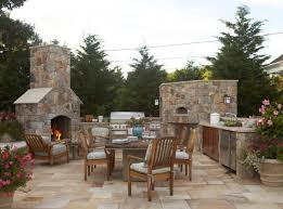 outdoor-summer-kitchen-idea-with-stone-cabinet-and-