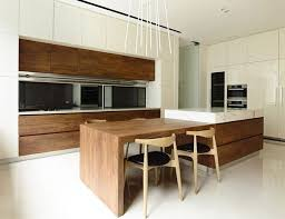 waterfall kitchen island looks great with the dark contrast cabinet on the  lowers