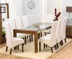 enhance your dining room with the arturo walnut gl top dining table set launched by furnitureinfashion