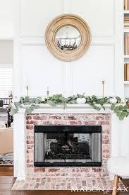 white mantel with white pumpkins and eucalyptus falldecor