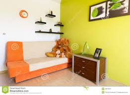 Orange And Green Bedroom White And Green Bedroom With Orange Sofa Stock Image Image 26076941
