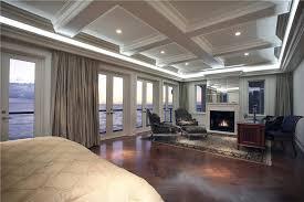 big master bedrooms couch bedroom fireplace: bedroom with multiple glass doors waterfront