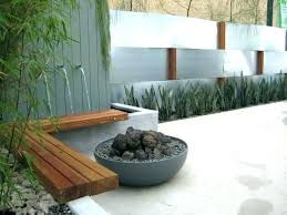 modern garden wall fountains fountain at night with stone retaining patio