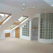 Modern and open plan attic conversion with old school glass tiled bathroom  area.