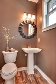 small bathroom wall decor ideas glass door gold accent and concrete walls chrome finish shower head