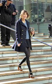 alexa chung wearing a long navy pea coat