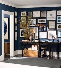 blue wall paint inspo --- Pottery Barn's partnership with Sherwin Williams  led to Naval blue as the backdrop to this well curated wall gallery, it's  navy ...