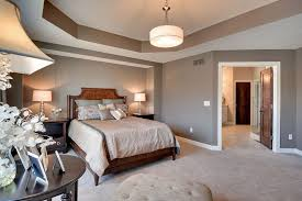2 tags Traditional Master Bedroom with High ceiling, Tray ceiling, Pendant  Light, Tufted ottoman,