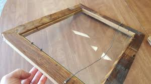 barn wood frame with glass disregard the wire hanger that will be removed