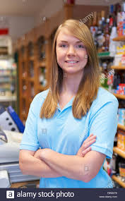 portrait of s assistant at supermarket checkout stock photo portrait of s assistant at supermarket checkout