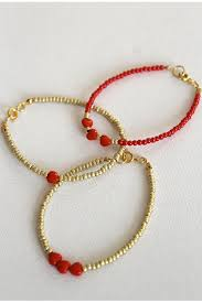 today s diy is a sweet friendship bracelet idea that can be made in any colourway you like i chose red and gold as its love season and i had a stash of