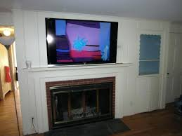 how to mount a tv above a fireplace tv mount into stone fireplace