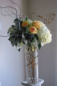 curly willow branch and rose centerpieces | Dusty miller, kiwi vine, curly  willow hydrangea