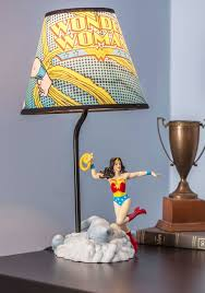 comic and collected lamp reading beneath the bold glow of this