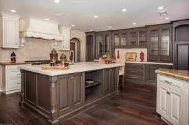 image of white kitchen cabinets with wood tile floor