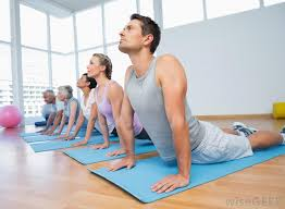 vinyasa yoga uses a series of poses or asanas that provide a challenging workout