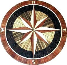 round nautical themed rug rugs compass rose wood flooring coastal