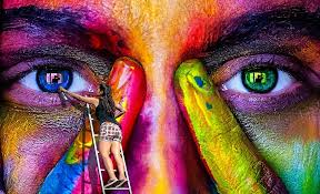 picture of a woman painting a mural of a face