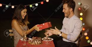 Young Woman Giving A Surprise Valentines Gift To Her Boyfriend.. Stock  Photo, Picture And Royalty Free Image. Image 64374672.
