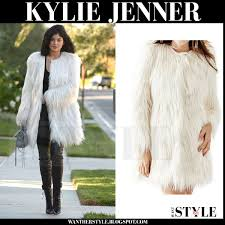 kylie jenner in white faux fur guess glam coat and black leather leggings what she wore