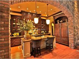 tuscan kitchen with pendant lights and stone arch the tuscan style lighting is great in