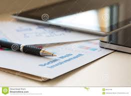 Digital Business Composition With Two Gadgets Pen And Papers