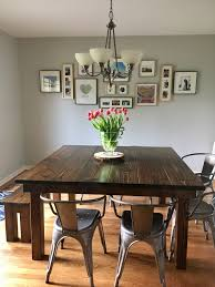 this 66 x 66 square farmhouse dining table features a traditional top in vine dark walnut with a dark walnut base looks right at home paired with a