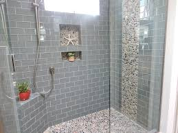 Example sea glass subway tiles for shower walls (would not use pebbles as  accent though