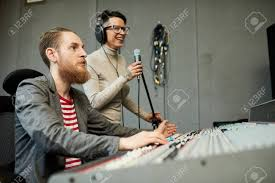 Designer The Singer Sound Designer And Singer Recording Song In Production Studio