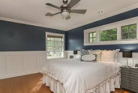 3 tags Transitional Master Bedroom with High ceiling, Ceiling fan, Hardwood  floors, Wainscoting, Crown