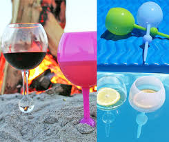 similar to the spiked beach drink holder that holds your drink up by pounding a spike into the sand the beach glass is an actual glass you drink from that