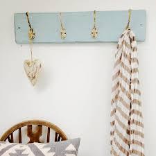 reclaimed wood coat hooks with rustic cream hooks
