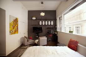decorating one bedroom apartment. Apartments, A One Bedroom Apartment White Wall Paint Glass Window Panel Bedlinen Sofa Set Decorating