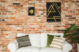 brick living room furniture. Stock Photo - White Comfortable Sofa In Modern Living Room With Red Brick Wall Furniture A