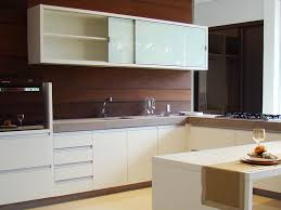 modern kitchen featuring af008 metal framed cabinet doors with back painted glass inserts in