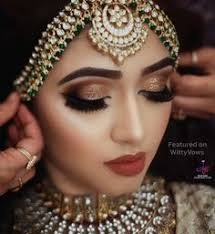 golden smokey eyes paired with a dull red lip bridal makeup ideas bridal