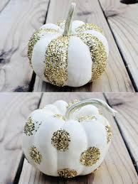 #5 USE GLITTER in various ways to decorate simple white pumpkins