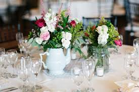 use vases and jars to provide extra character to your wedding centerpieces ideas select flowers that will nicely complement your color scheme and chosen