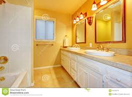 Gold Bathroom Bathroom With White Cabinets And Gold Walls Stock Images Image