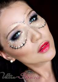 a subtle crystal accented masquerade make up mask pliments pretty purple smokey eyes