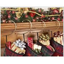 christmas stocking hooks.  Hooks BRASS GRAVITY DEFYING CHRISTMAS STOCKING HOOK HANGERS  SET OF 4 BY JUMBL Throughout Christmas Stocking Hooks Amazoncom