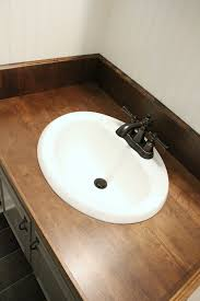 diy wood bathroom countertop how we replaced our ugly formica countertops in one weekend