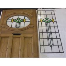 1930 s art deco original exterior door in green and amber also addtional side panel