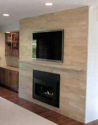 heat and glo electric fireplace x plank tile in beige on fireplace surround installed linear with