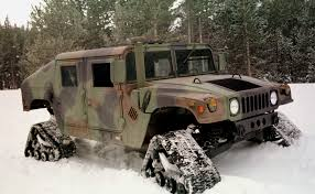 an hmmwv equiped with snow treads