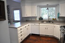 excellent curved white wooden kitchen cabinet ideas grey marble countertop brown laminate floor arch chrome faucet