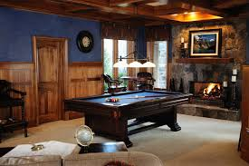 chalet rustic style man cave with small stone faced fireplace billiards table small wooden