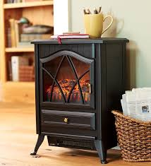 compact electric stove is portable efficient and attractive warm small rooms and spaces with this electric heater electric wood stove heats up to 400 sq