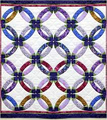 Quilt Inspiration: Wedding Ring Quilt Inspiration... and free patterns & The Double Wedding Ring design - first published in 1928 - is believed to  be a variation of an even older pattern called Pickle Dish (see the article  by ... Adamdwight.com