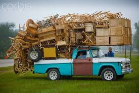 Overloaded furniture carrying truck